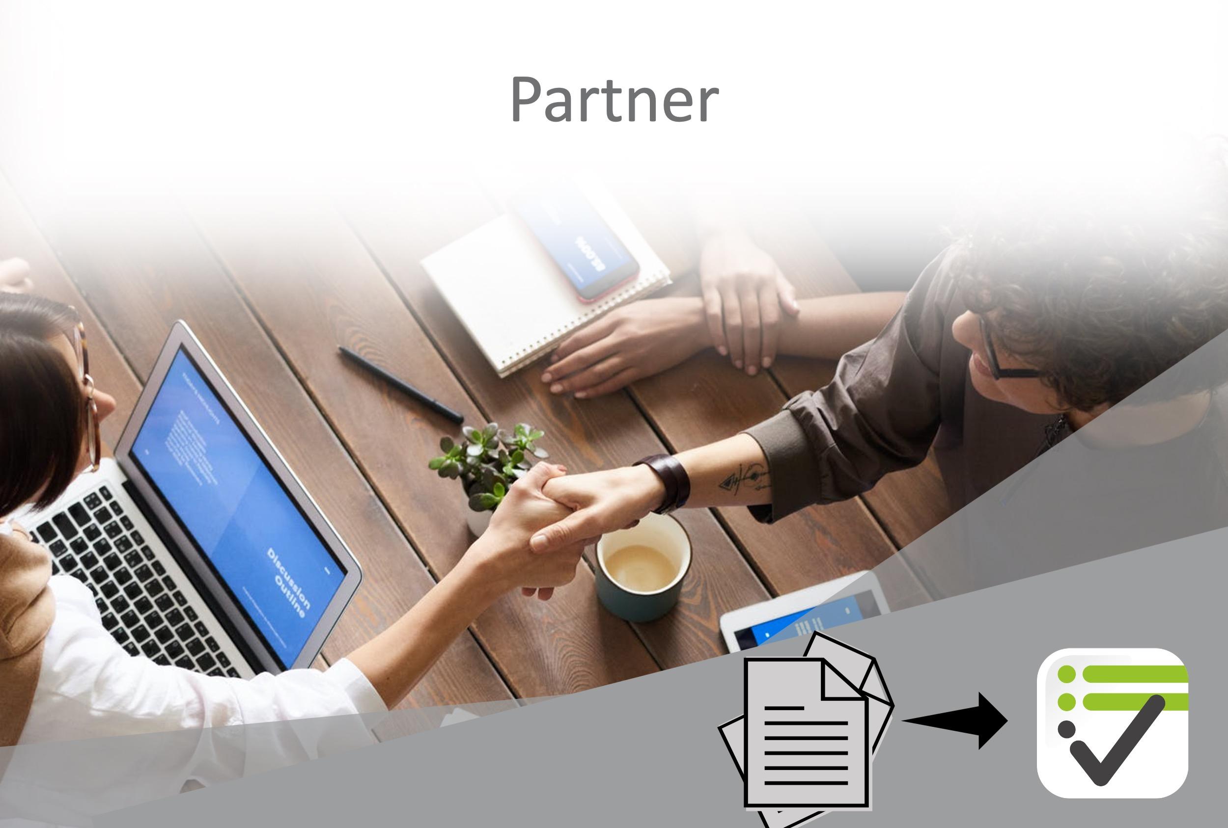 Zwei menschen reichen sich die Hand zur Partnerschaft.
